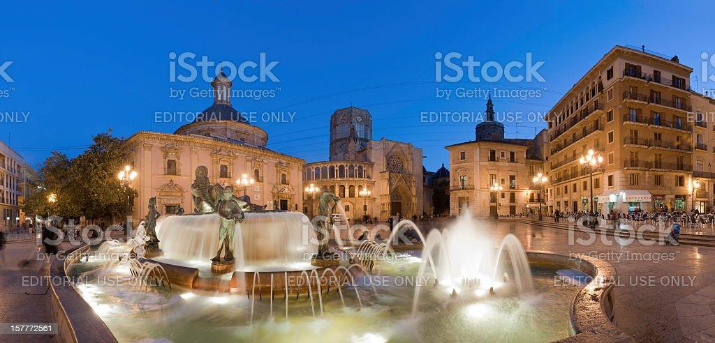 Illuminated fountain plaza panorama Valencia stock photo