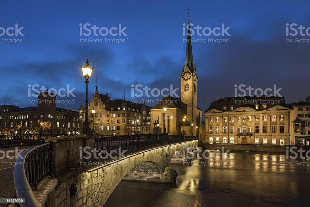 Illuminated Fraumunster Church and River Limmat in Zurich stock photo