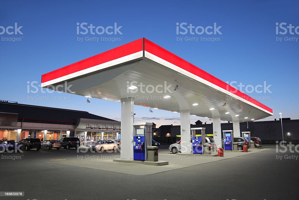 Illuminated Gas Station at Sunset stock photo