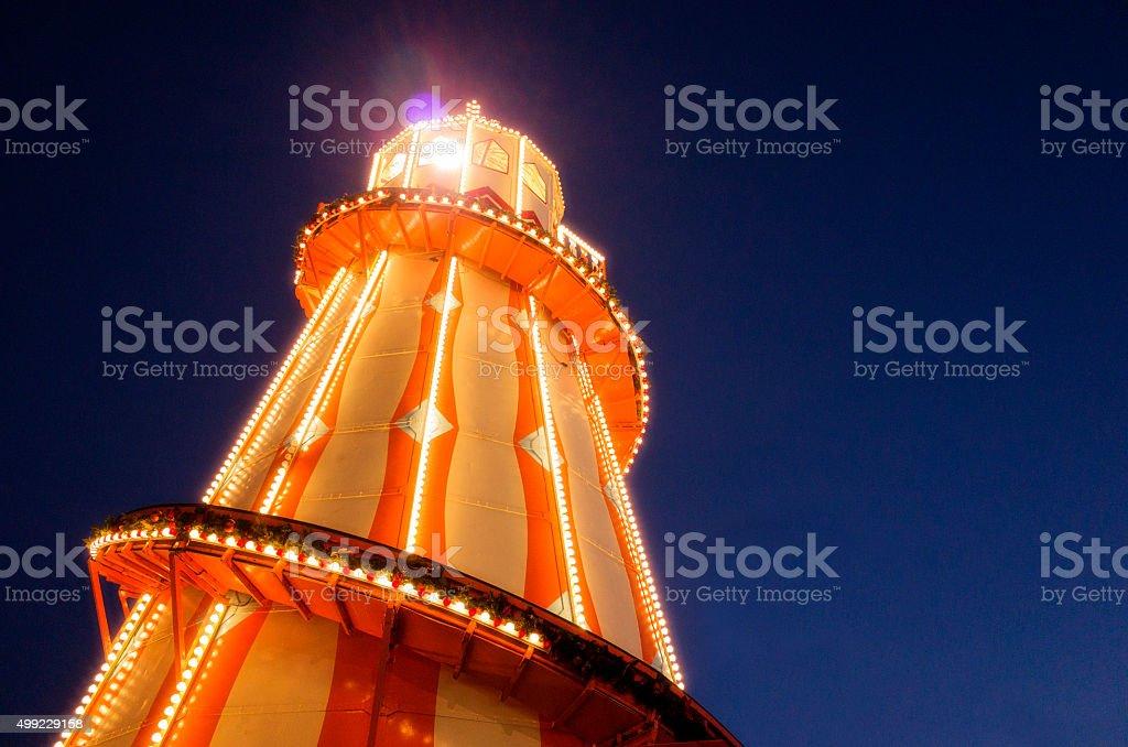 Illuminated Generic Helter Skelter at Night stock photo