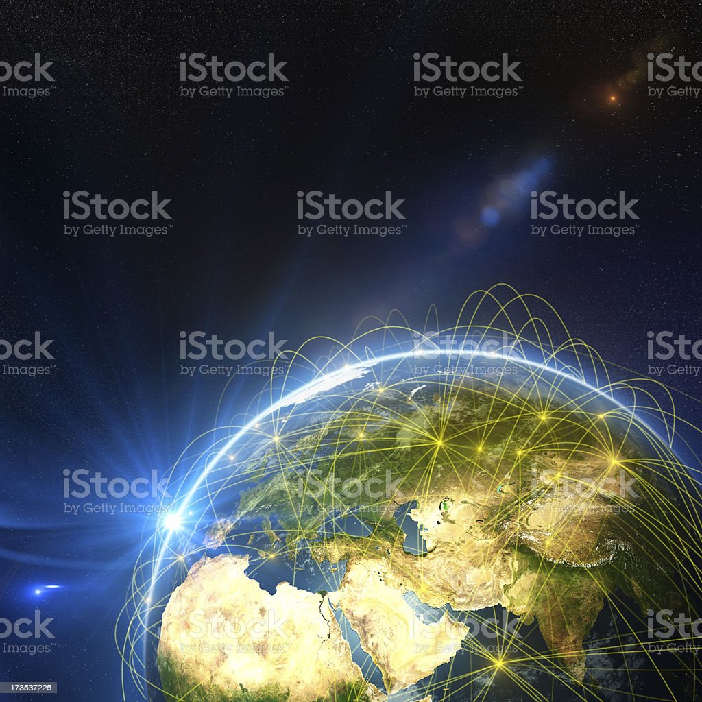 Illuminated globe with communications rings stock photo