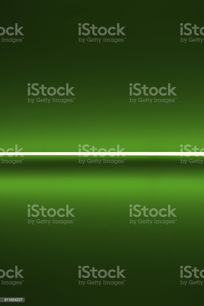 Illuminated green wall with a white strip royalty-free stock photo
