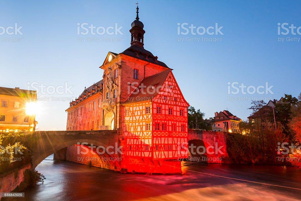 Illuminated historic town hall of Bamberg stock photo