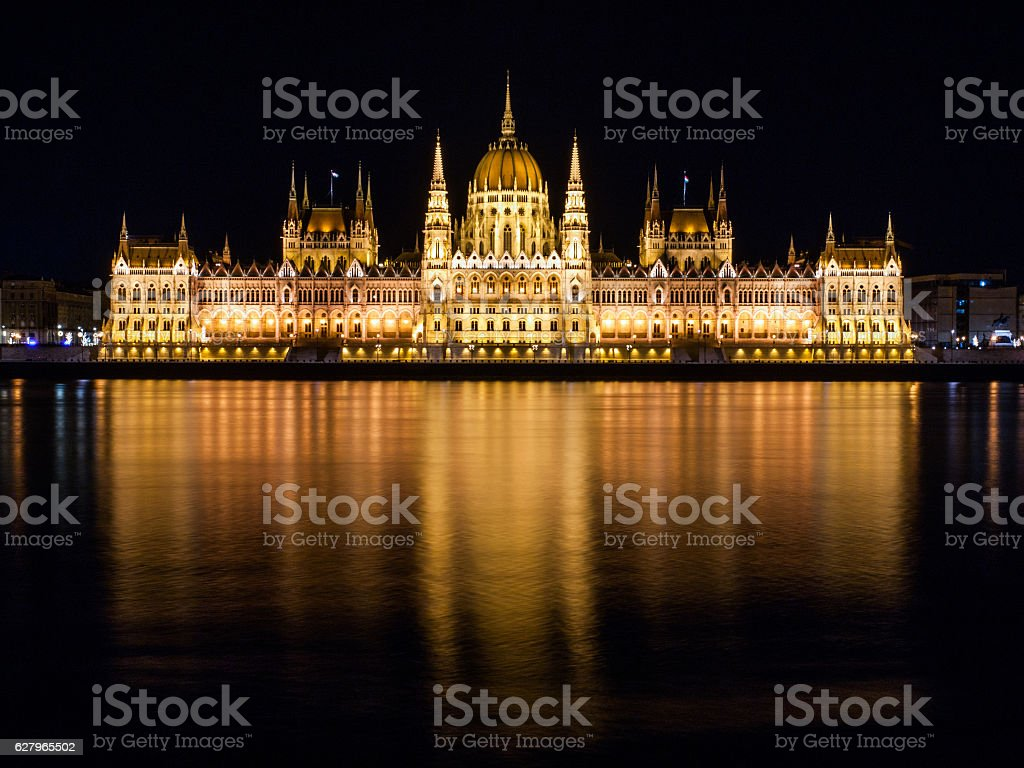 Illuminated historical building of Hungarian Parliament on Danube River Embankment stock photo