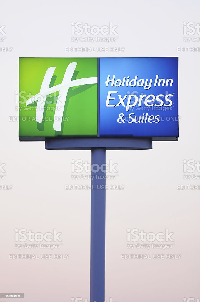 Illuminated Holiday Inn Express and Suites Sign royalty-free stock photo