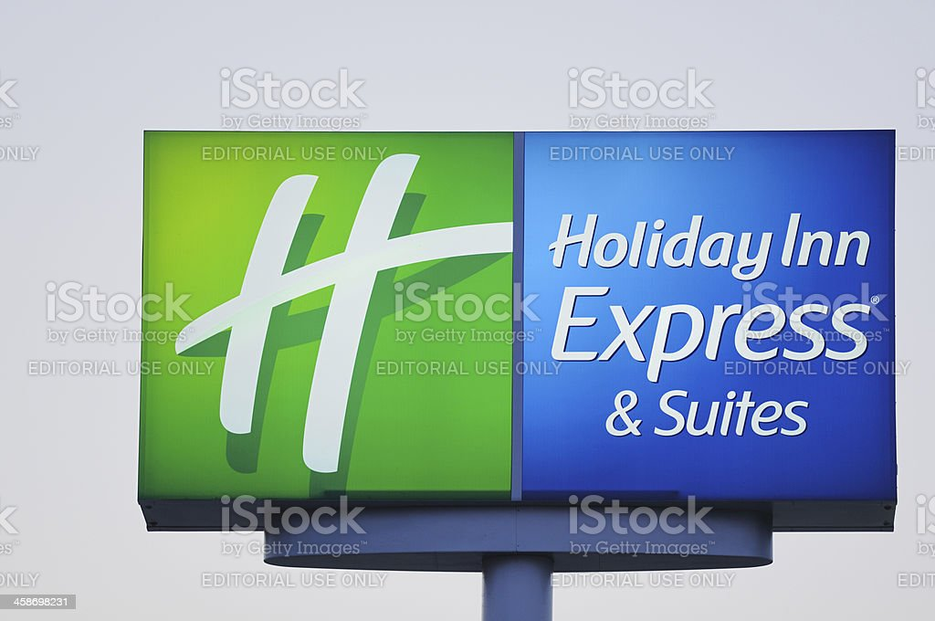 Illuminated Holiday Inn Express and Suites Sign stock photo