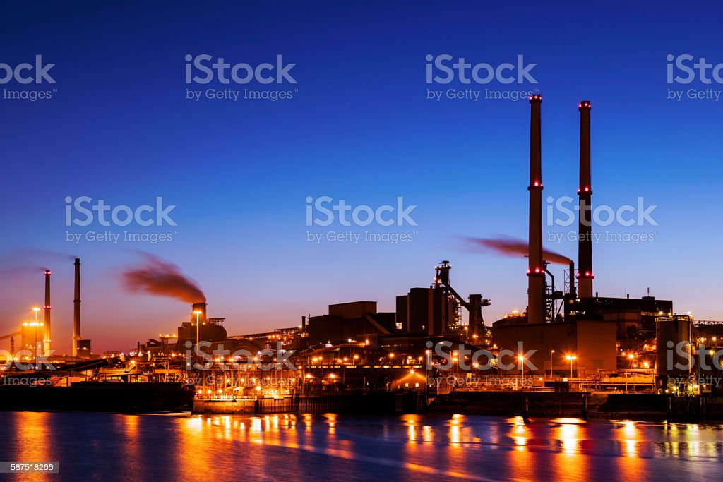 Illuminated Industrial Plant on the River at Night,  Amsterdam, Netherlands stock photo