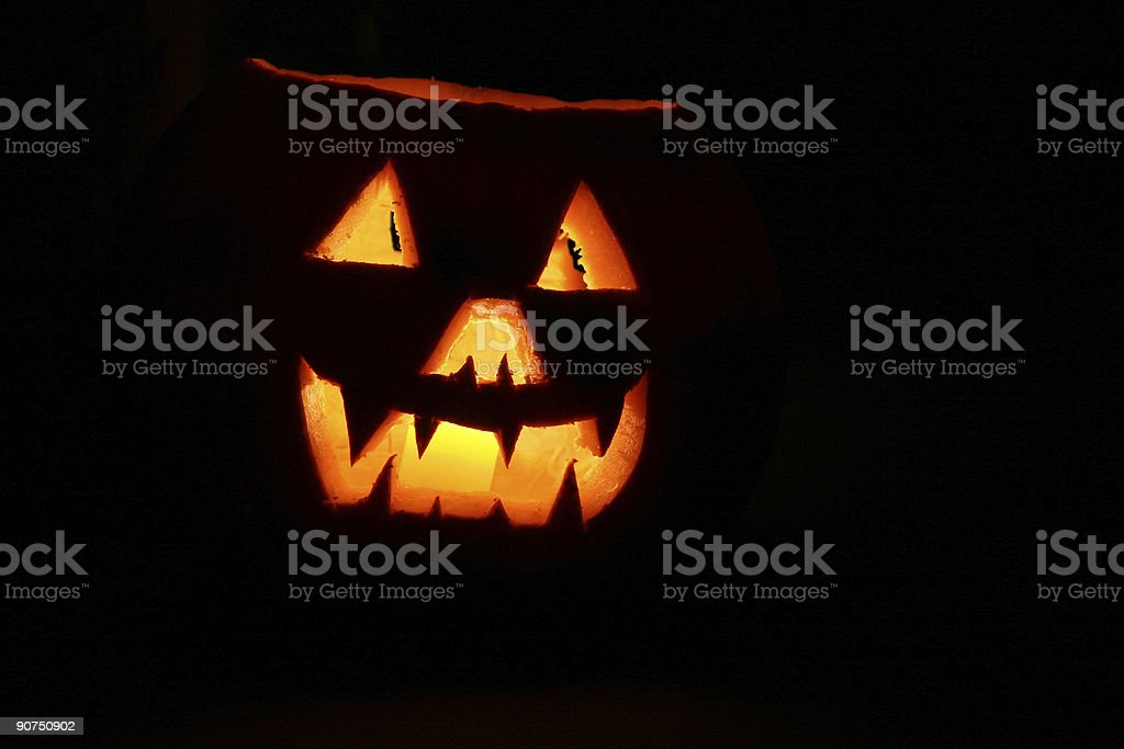 Illuminated Jack-o-Lantern for Halloween. Night. Orange, black. royalty-free stock photo