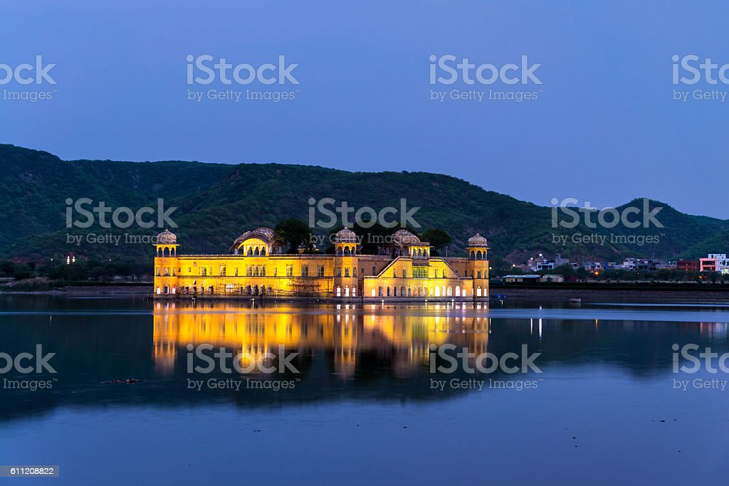 Illuminated Jal Mahal palace at night in Jaipur stock photo