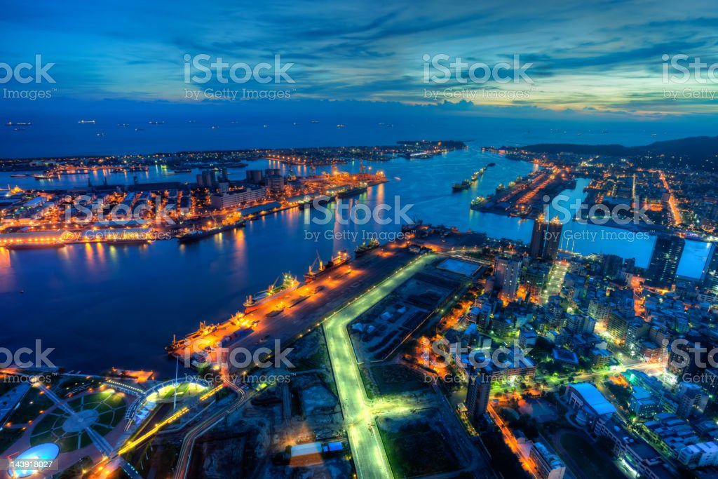 Illuminated Kaohsiung city and harbor at night skyline, Taiwan cityscape royalty-free stock photo