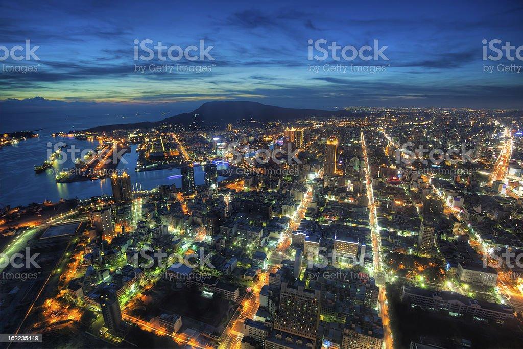 Illuminated Kaohsiung city and harbor at night skyline, Taiwan cityscape stock photo