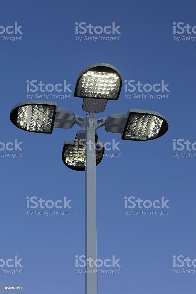Illuminated LED Streetlight against a Clear Blue Sky royalty-free stock photo