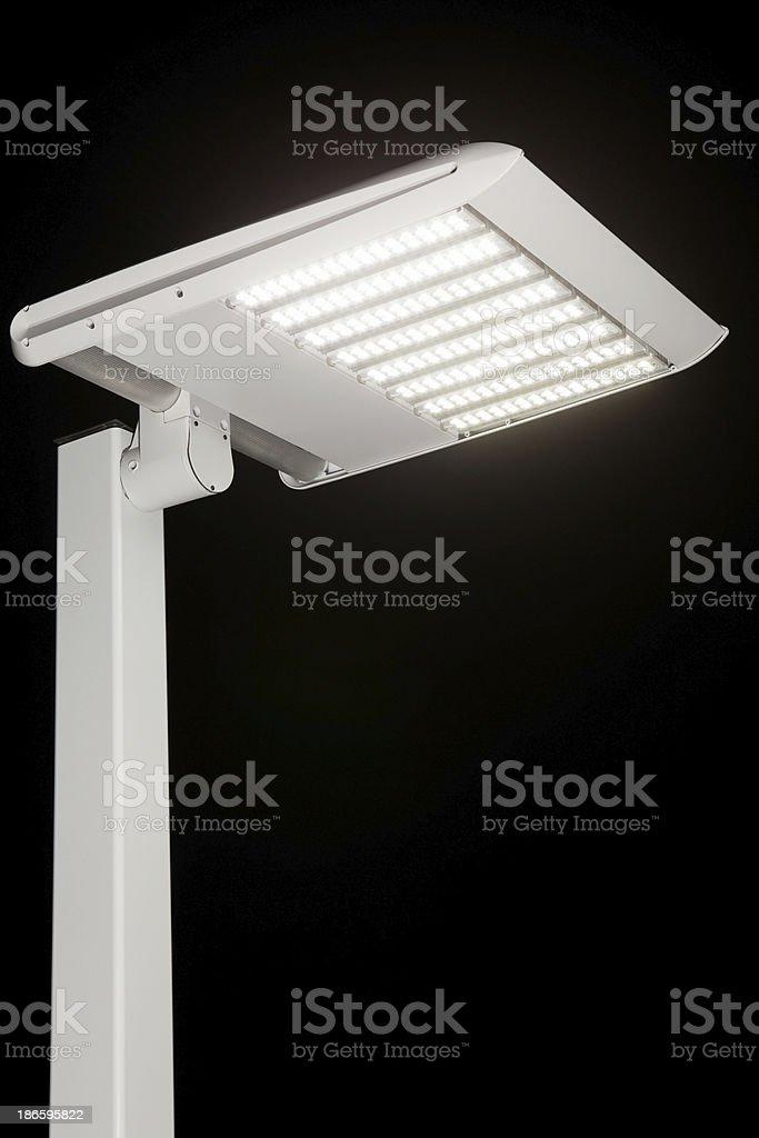 Illuminated LED Streetlight against a Night Sky royalty-free stock photo