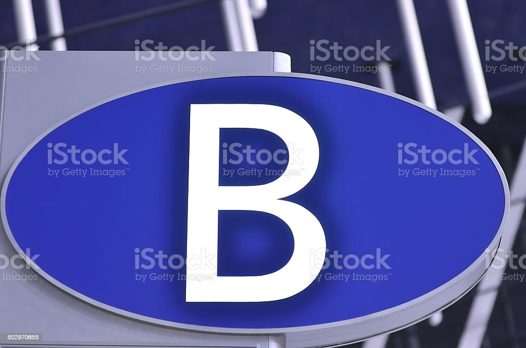 Illuminated letter B sign on check-in gate at the airport stock photo