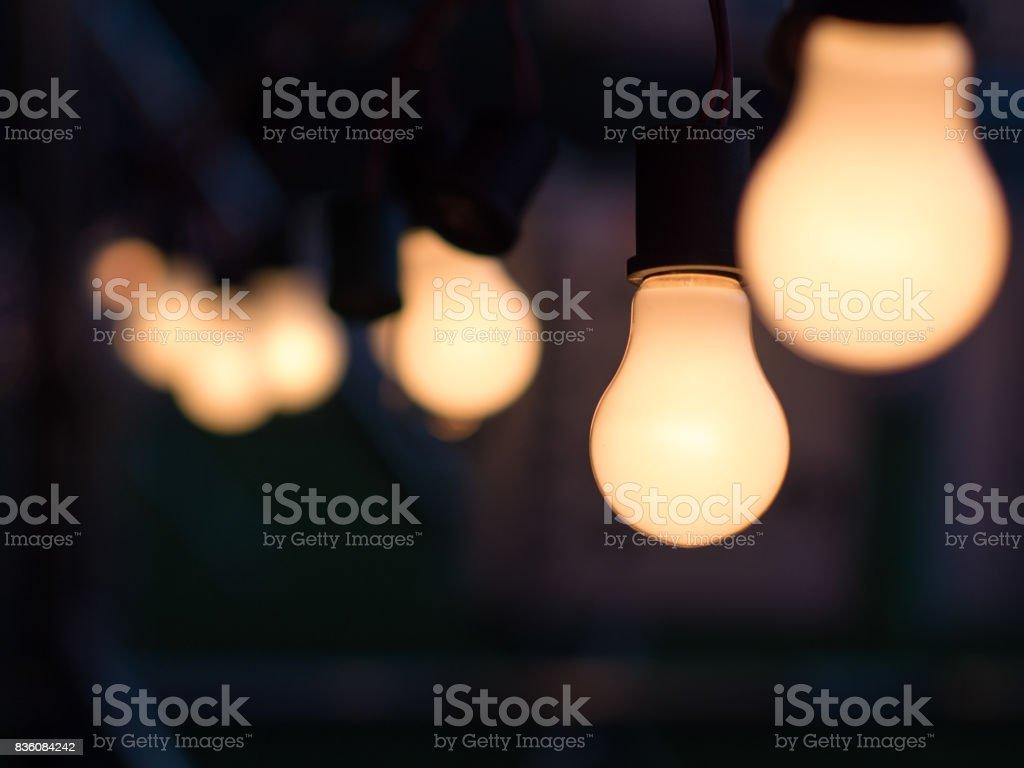 Illuminated light bulb at night, business idea concept stock photo