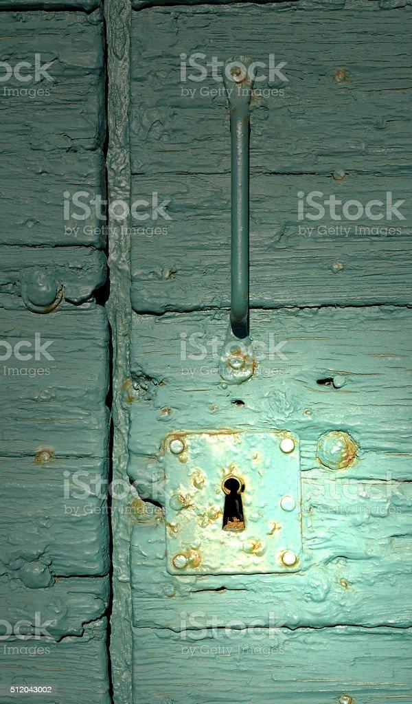 illuminated lock of a green door stock photo
