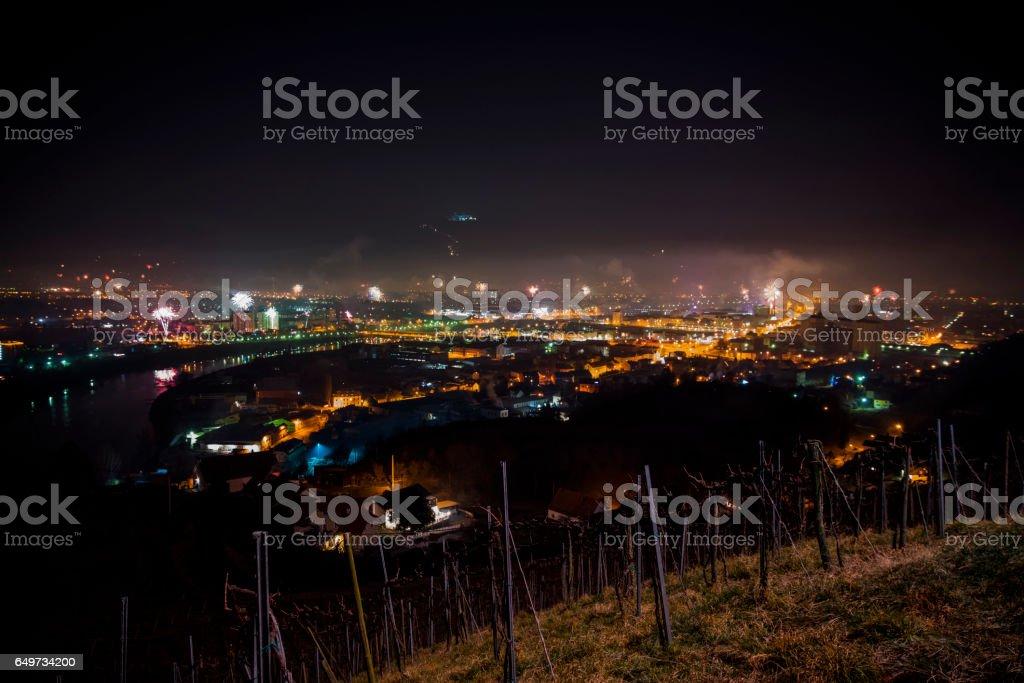 Illuminated Maribor city with fireworks at night stock photo