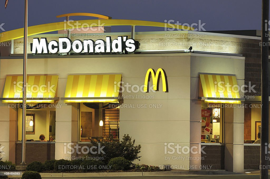 Illuminated McDonald's restaurant at dusk royalty-free stock photo