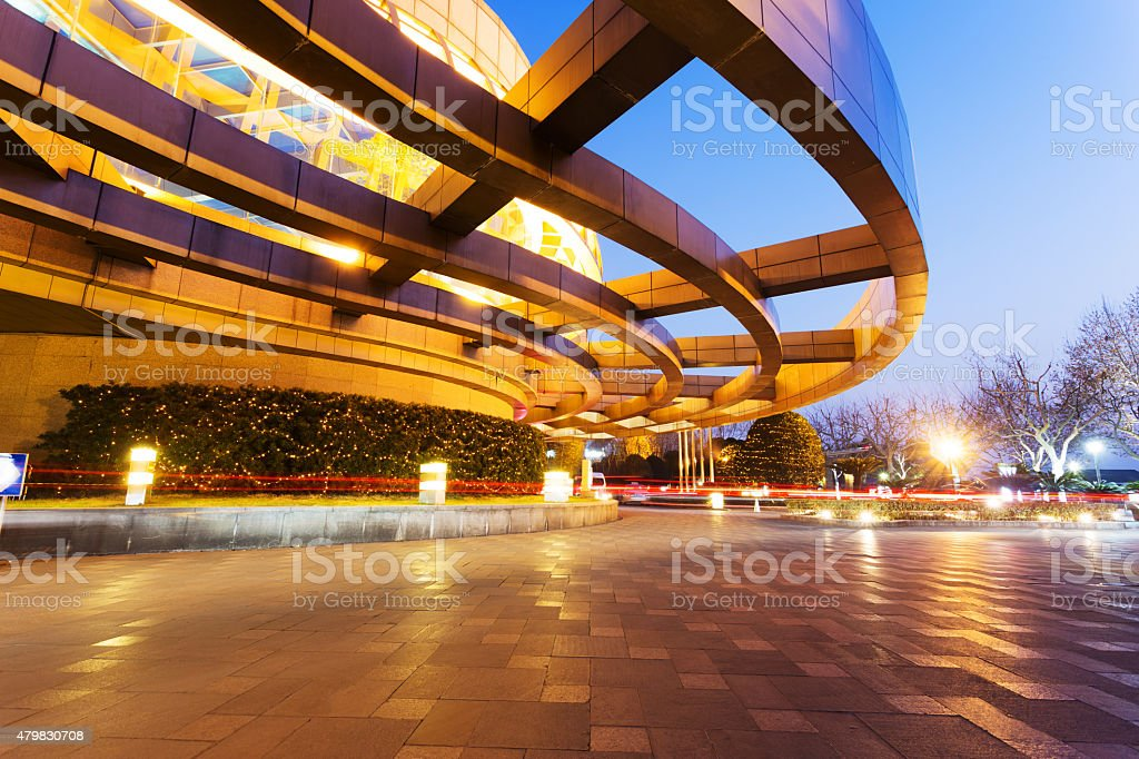 Illuminated modern building exterior and  empty street stock photo