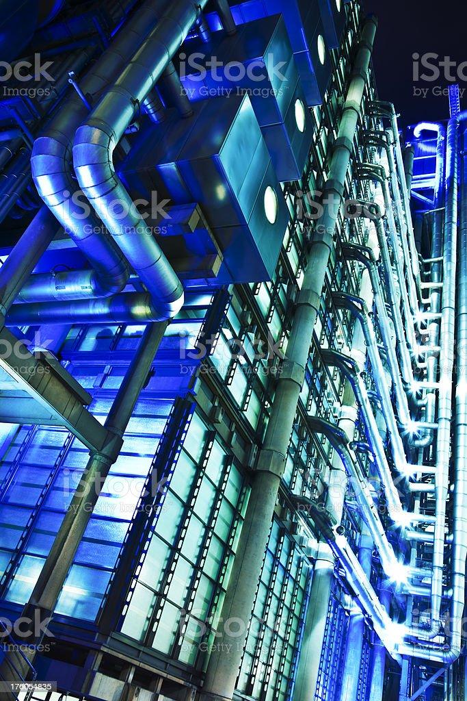 Illuminated Modern Lloyds Building in London at Night stock photo