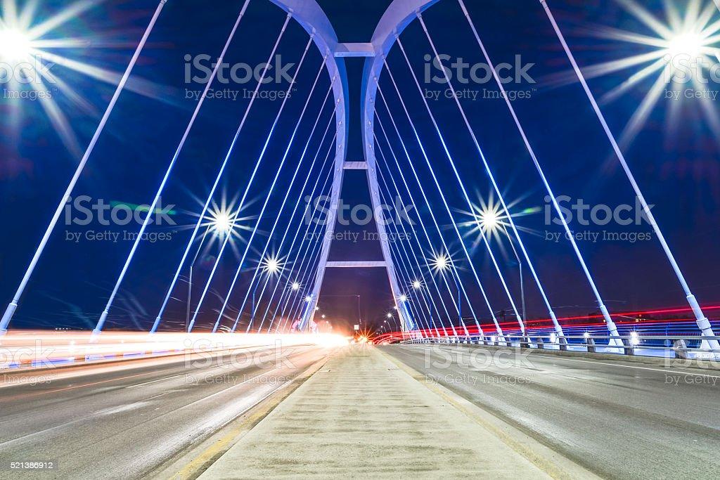 Illuminated Modern Lowry Avenue Bridge with Light Trails stock photo