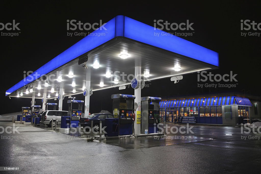 Illuminated Modern Service Station at night royalty-free stock photo