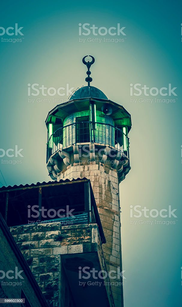 Illuminated mosque in Old City of Jerusalem in the evening. stock photo