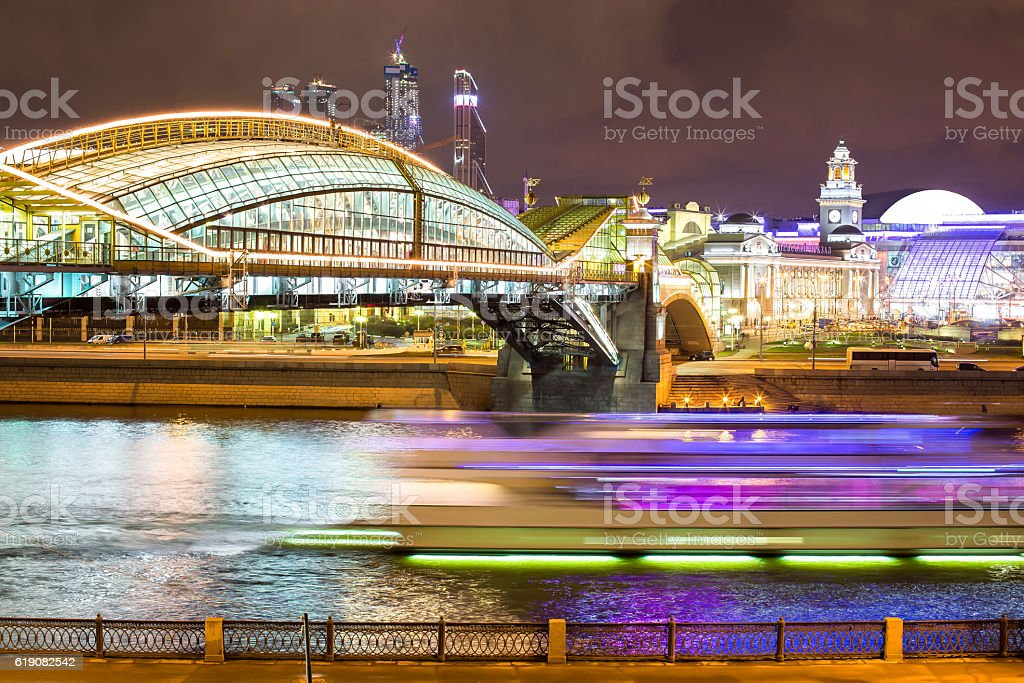 Illuminated night bridge in Moscow with colorful reflections stock photo