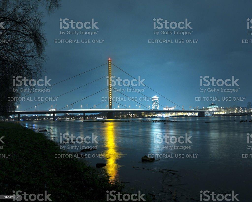 illuminated Oberkasseler Brucke and Dusseldorf cityscape at night stock photo