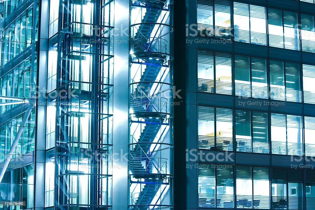 Illuminated office building at night, London, England stock photo