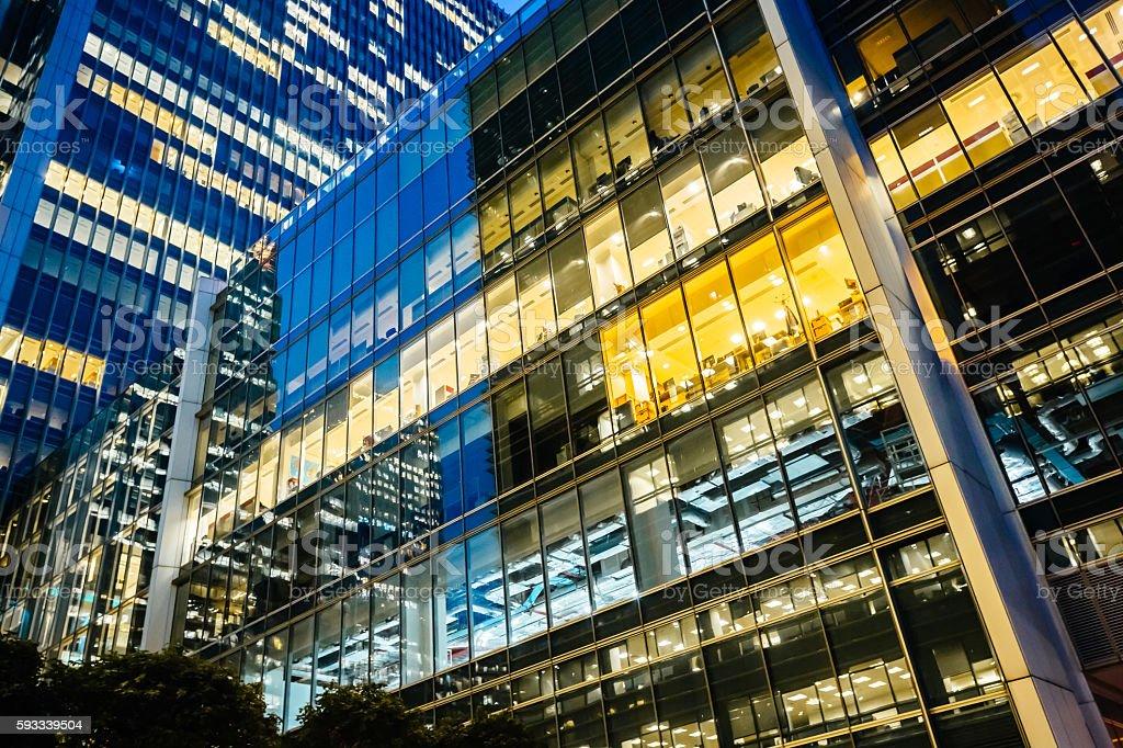 Illuminated office buildings at Canary Wharf, London at Night stock photo