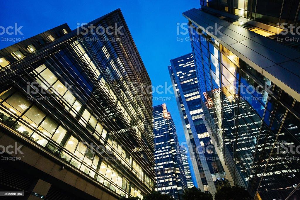 Illuminated office buildings Canary Wharf, London at Night stock photo