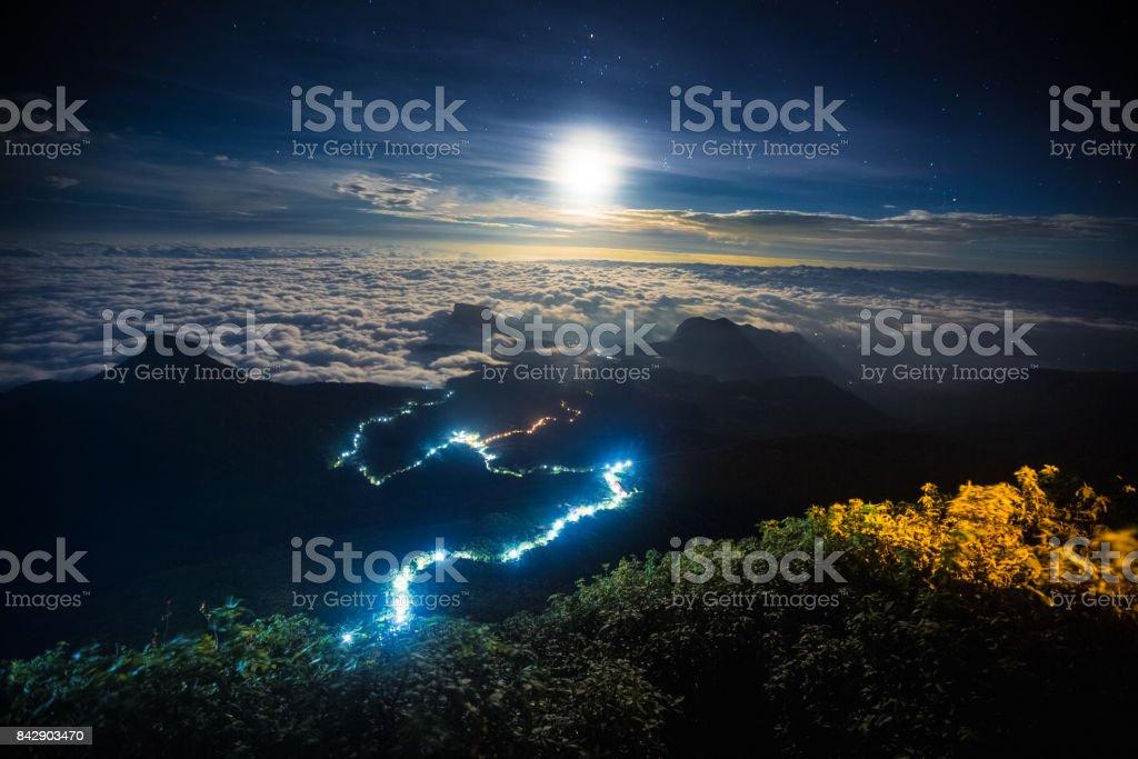 Illuminated path to the top of the mountain of Adams Peak stock photo