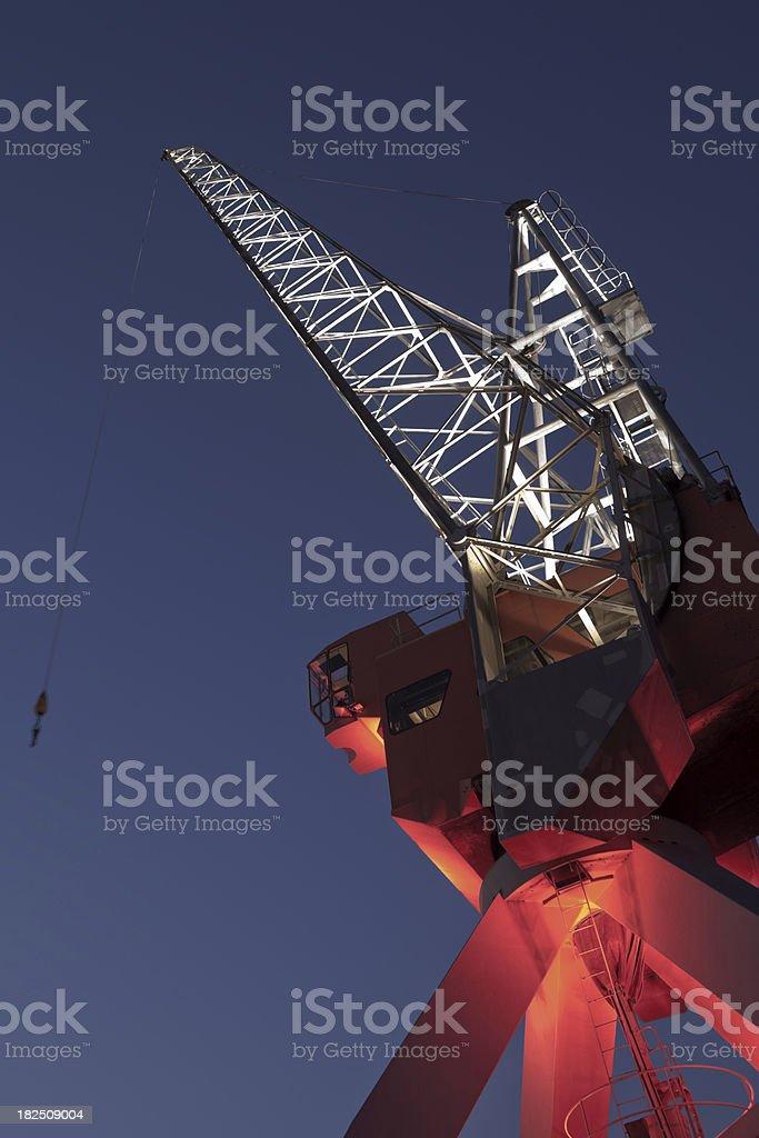 illuminated port crane at dusk royalty-free stock photo