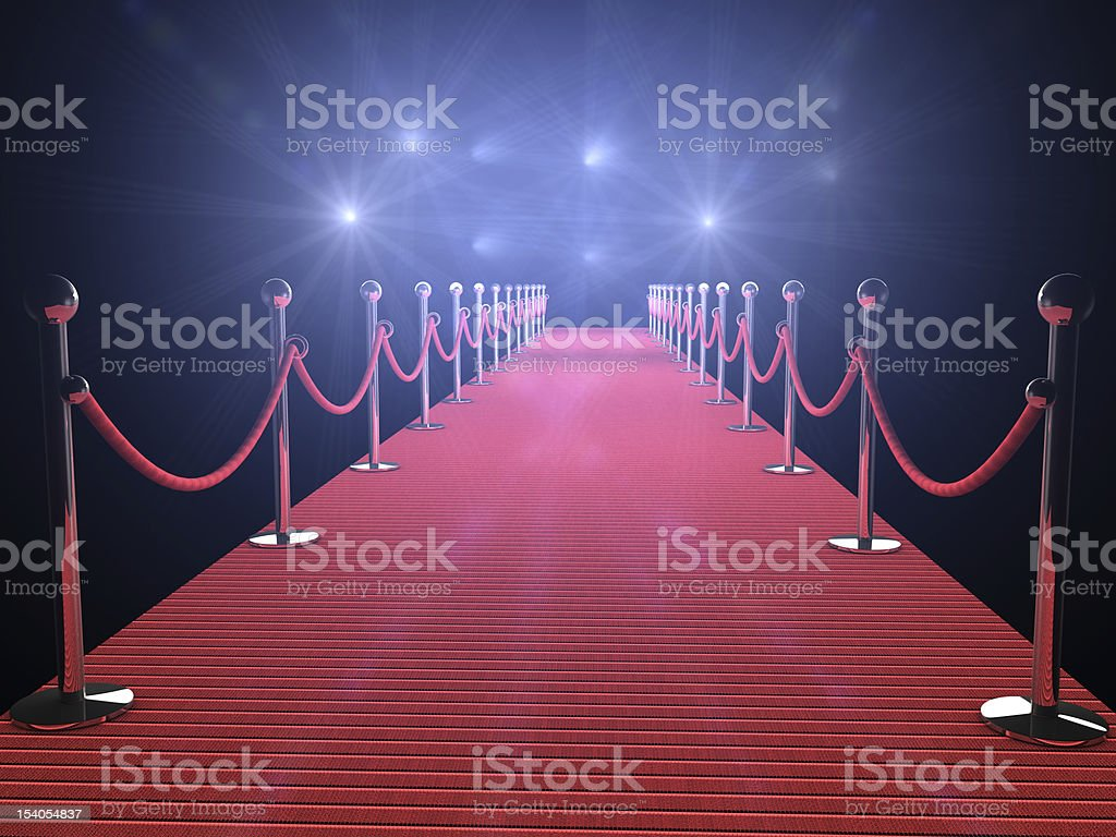 Illuminated red carpet with flashing lights and black walls stock photo