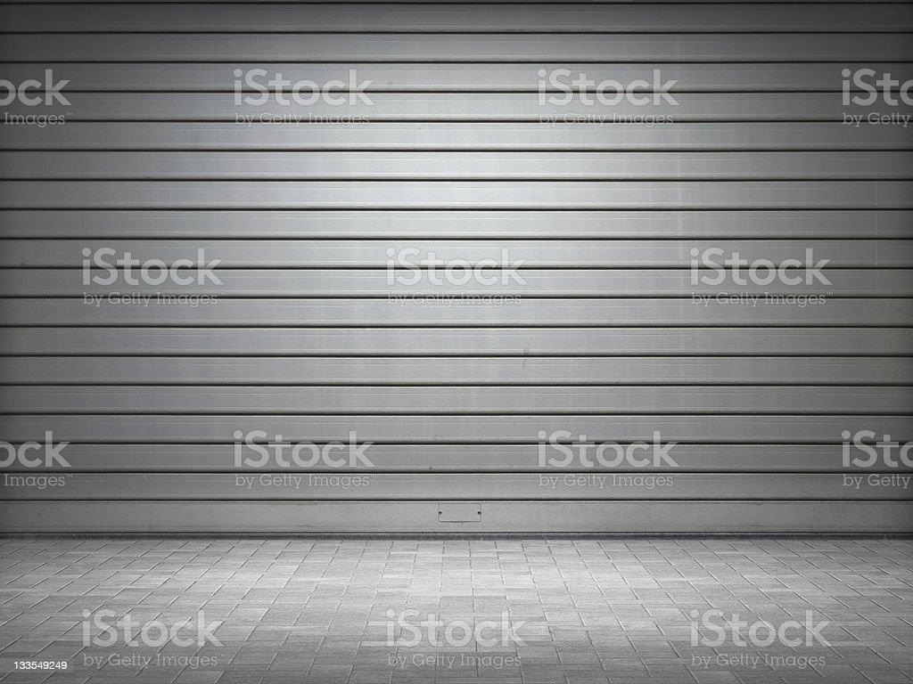 Illuminated roller shutter door stock photo