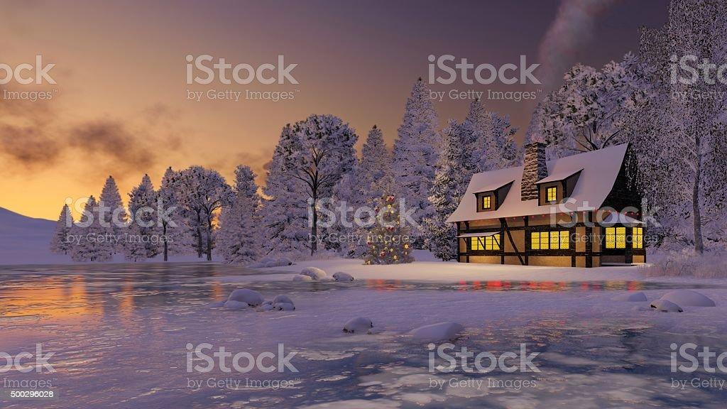 Illuminated rustic house and christmas tree at sunset stock photo