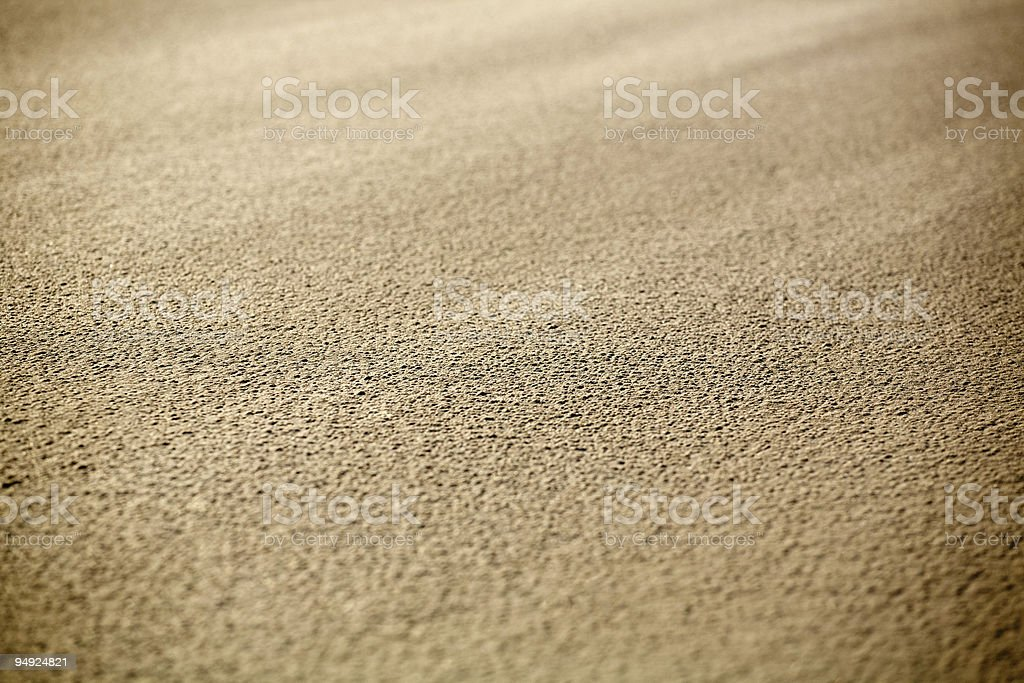 Illuminated sand close-up background royalty-free stock photo