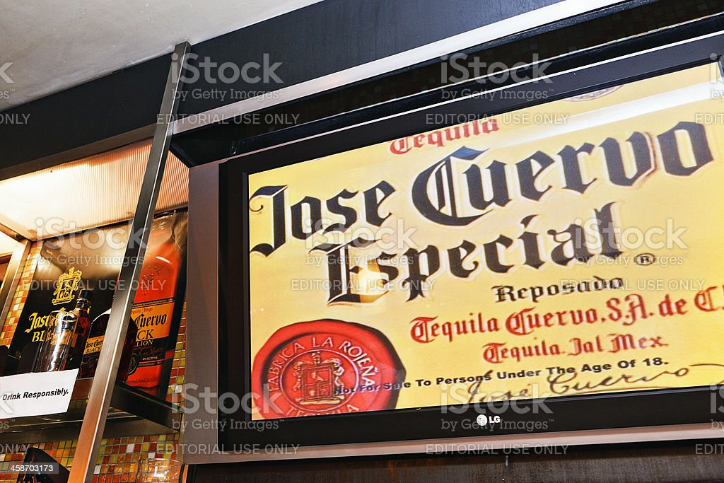 Illuminated sign advertises Jose CuervoEspecial tequila in bar stock photo