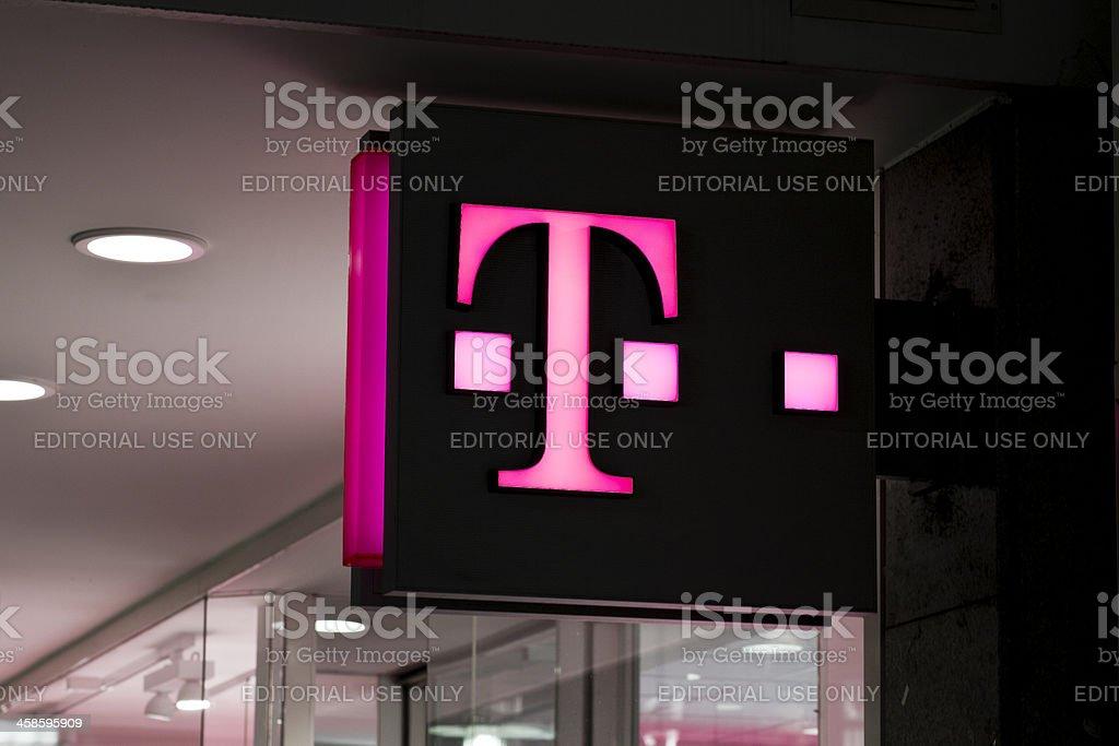 Illuminated sign of Telekom Shop, Wiesbaden stock photo