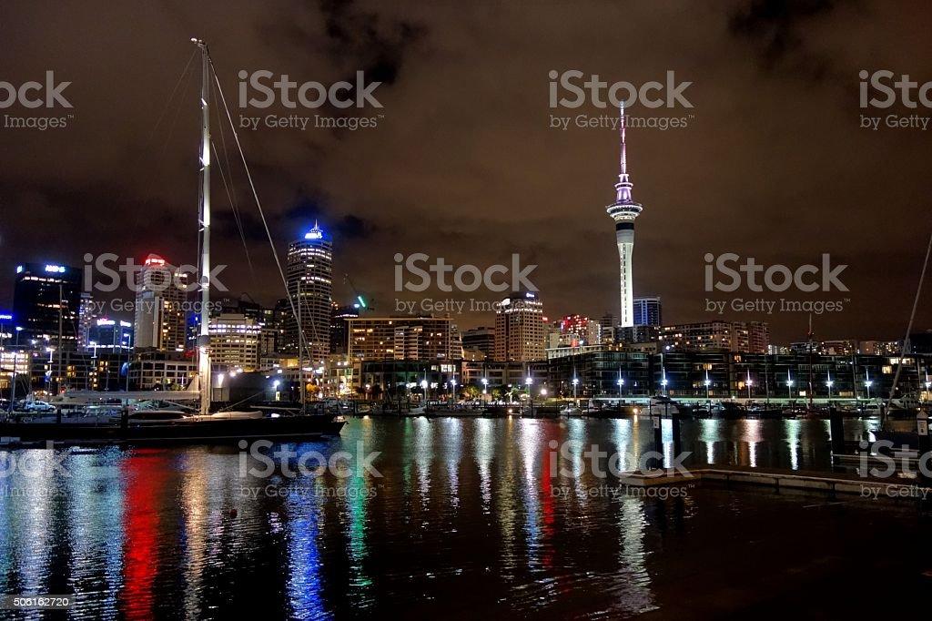 Illuminated Skyline in Auckland marina stock photo