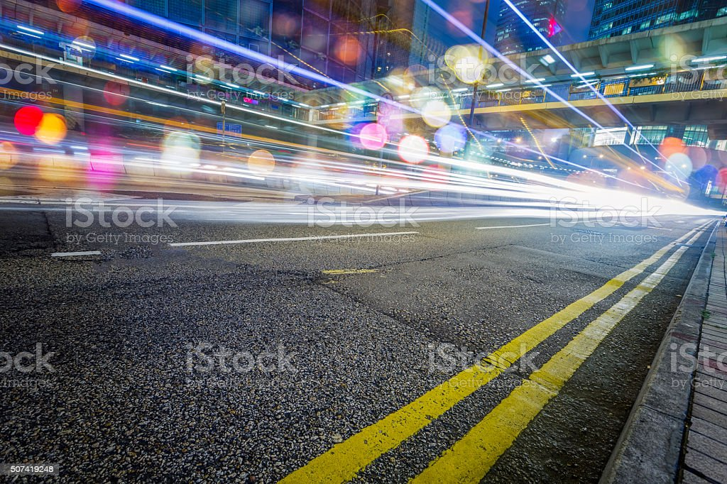Illuminated Skyscrapers and City Streets in Hong Kong stock photo