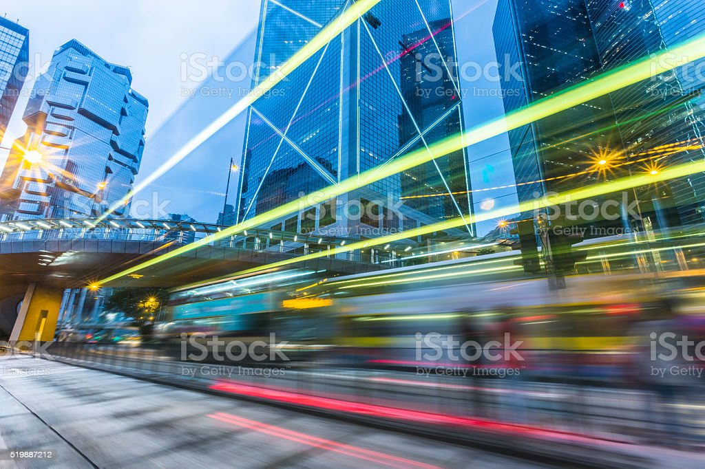 Illuminated Skyscrapers and light trails  in Hong Kong stock photo