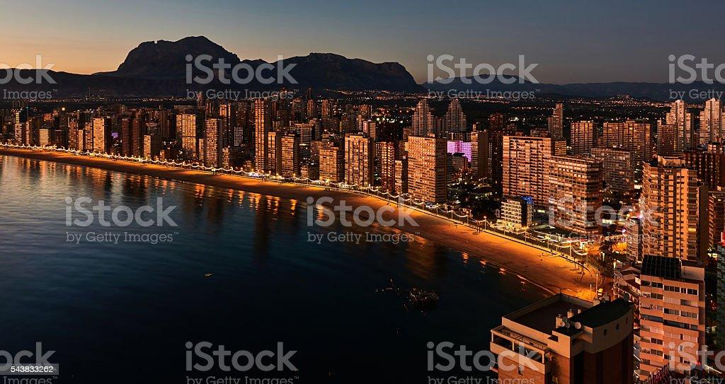 Illuminated skyscrapers of a Benidorm city at night. Spain stock photo