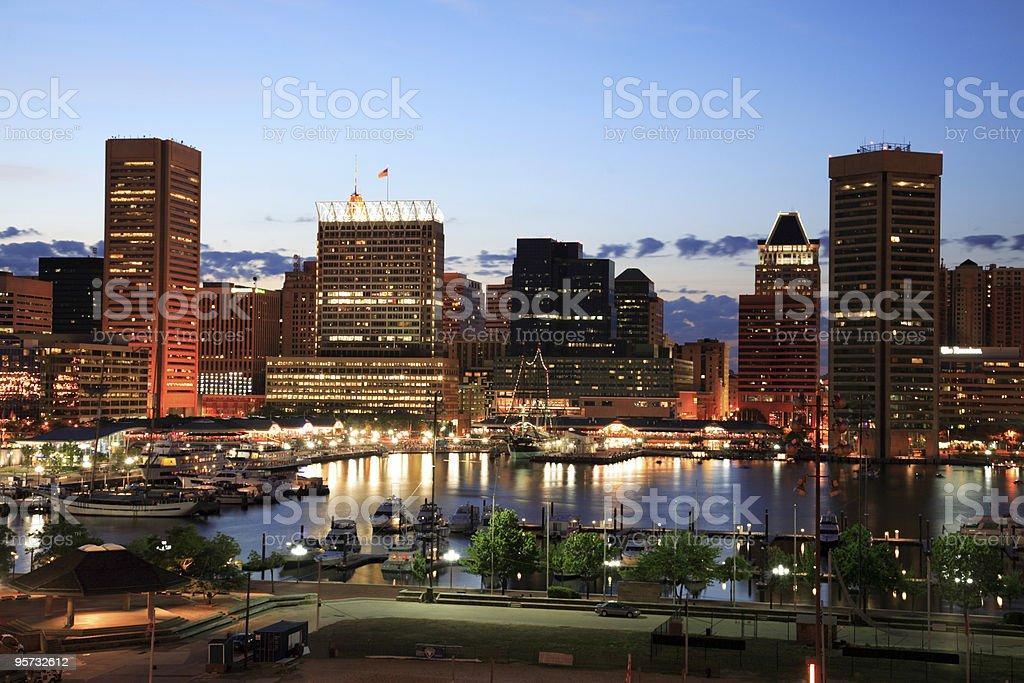 Illuminated skyscrapers of Inner Harbor, Baltimore, Maryland stock photo