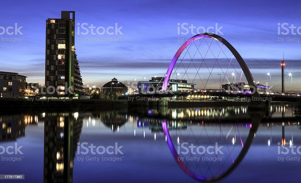 Illuminated Squinty Bridge crossing the River Clyde, Glasgow, Scotland stock photo
