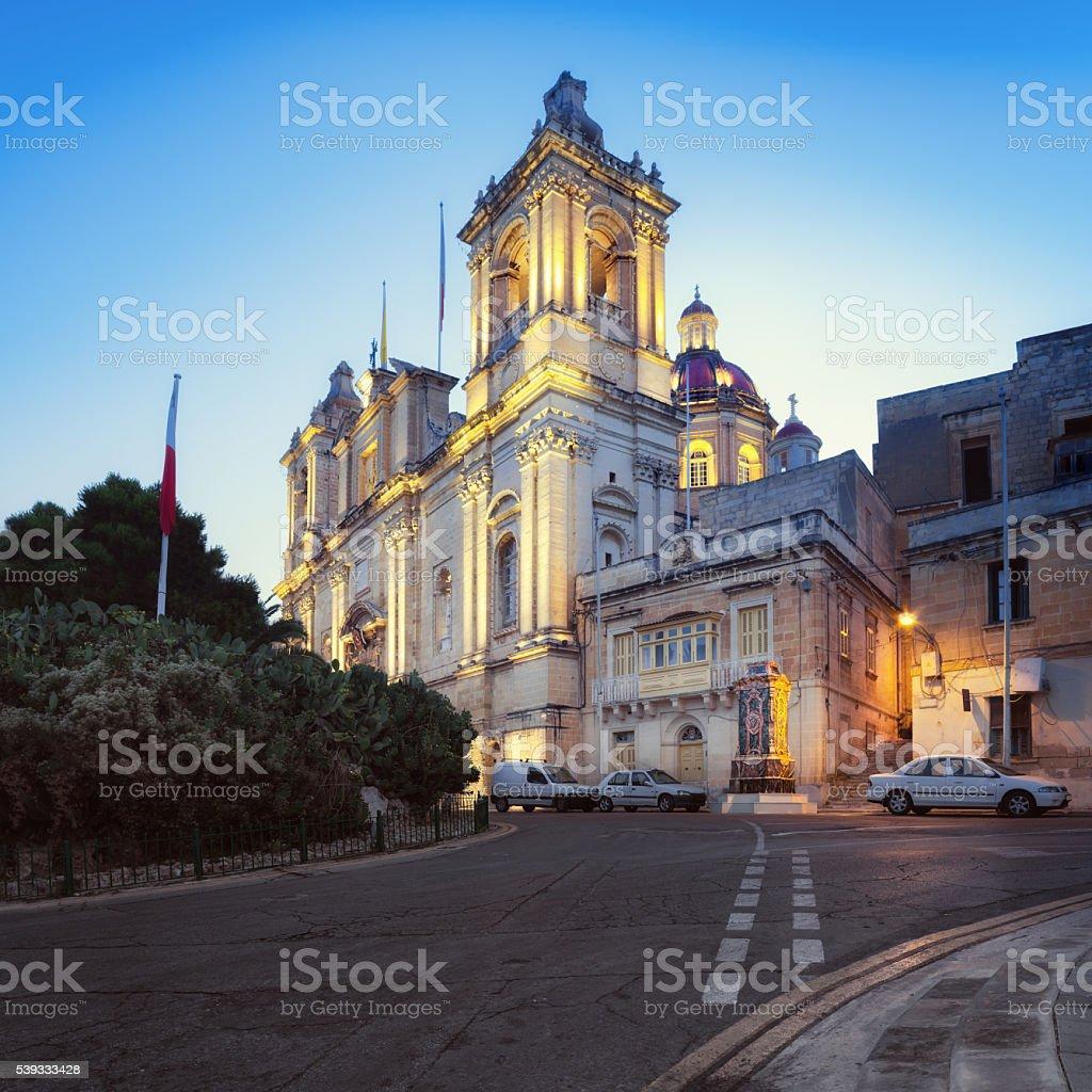 Illuminated St. Lawrence Church in Vittoriosa, Malta stock photo