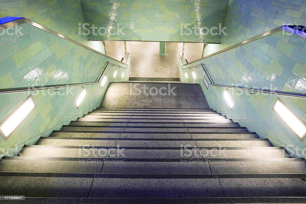 Illuminated Stairs at Night, Underground Station Alexanderplatz, Berlin, Germany stock photo