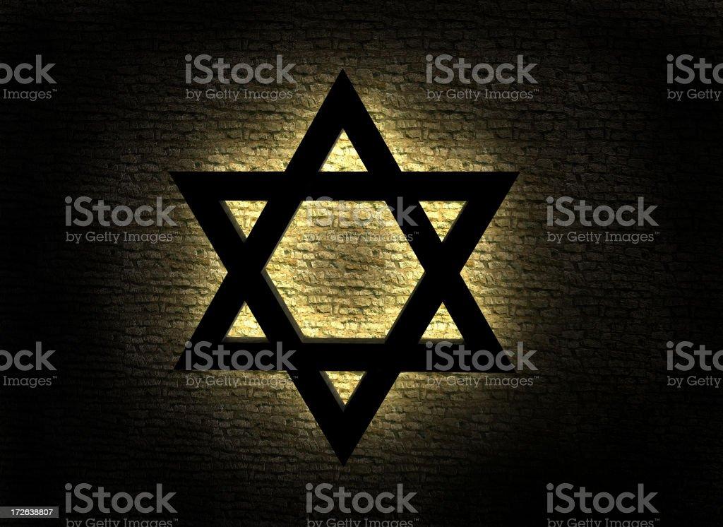 Illuminated Star of David on a dark background stock photo