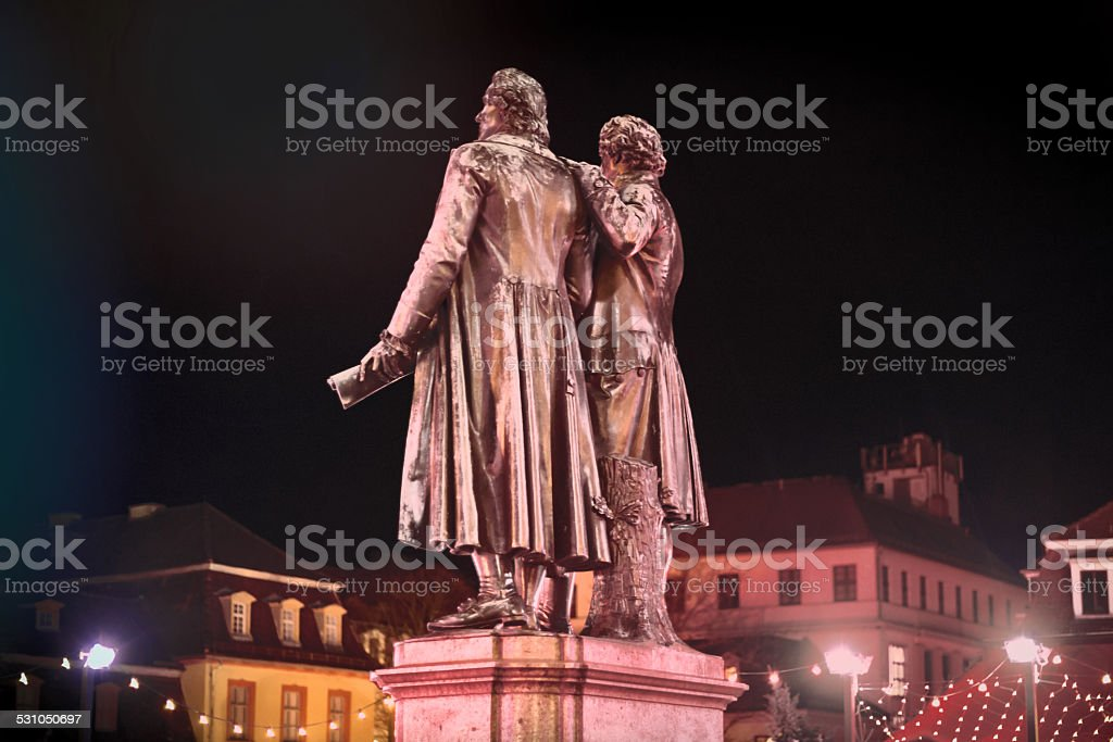 illuminated staue of Goethe and Schiller in Weimar, Germany stock photo